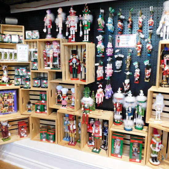 Assortment of Nutcrackers on a shelf at the Just Christmas Store