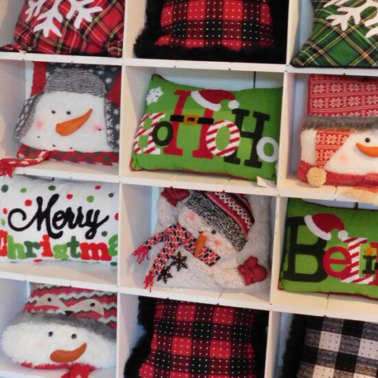 Assortment of Christmas pillows on a shelf