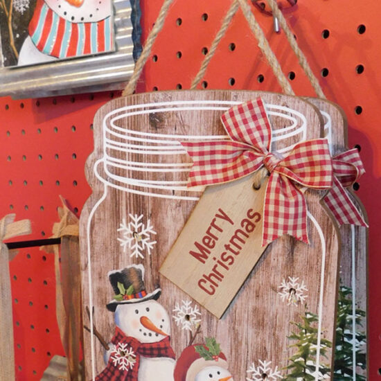 Assorted Christmas signs hanging on a wall
